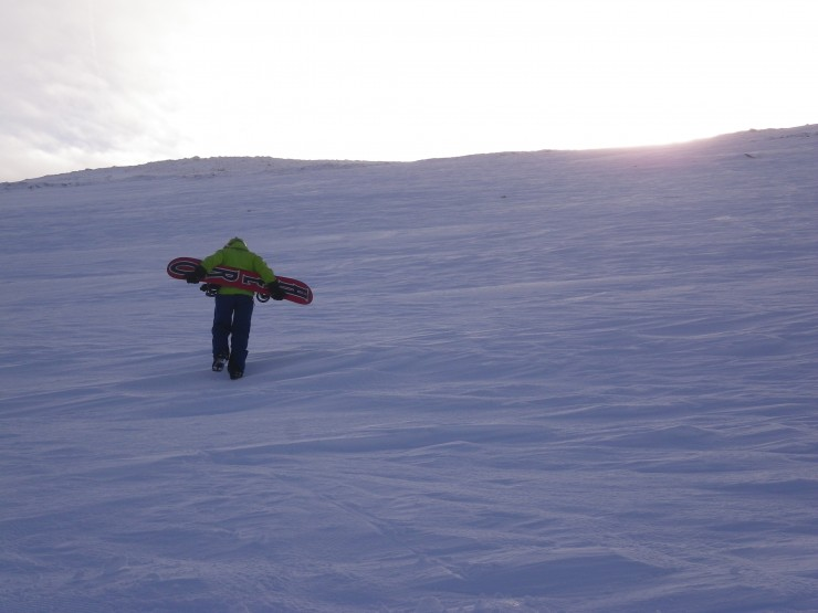 A snowboarder heads up Marquis Well on Cairngorm