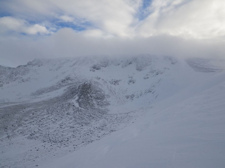 Cloud lifting briefly showing the cliffs of Coire an Lochain