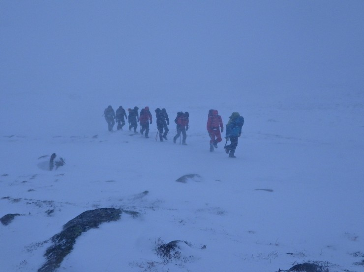A party beating into the blizzard in Coire Chais