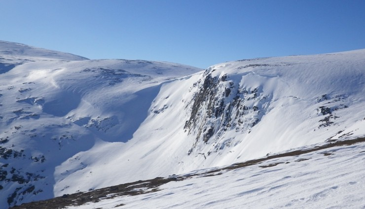 Cornices above East aspects on Hells Lum crag the Feith Bhuidhe in the background