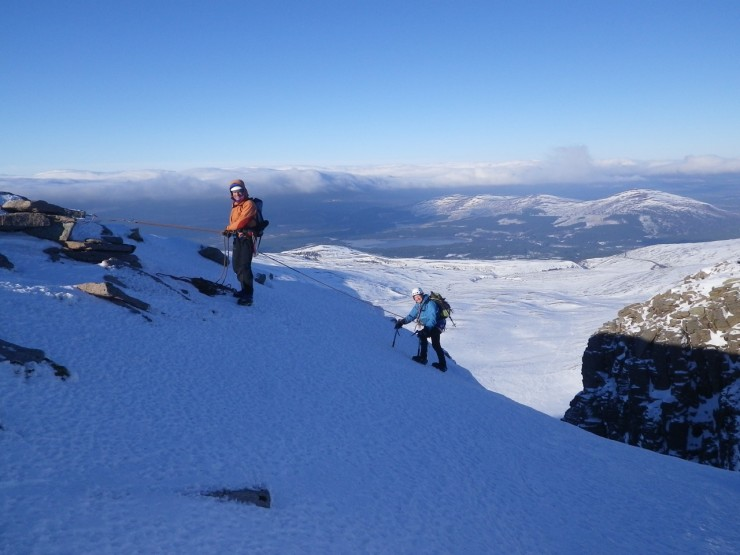 Happy climbers topping out from 'Milky Way' in Coire an Lochain