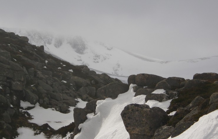 Peering through this small melt water channel on the Aonach ridge