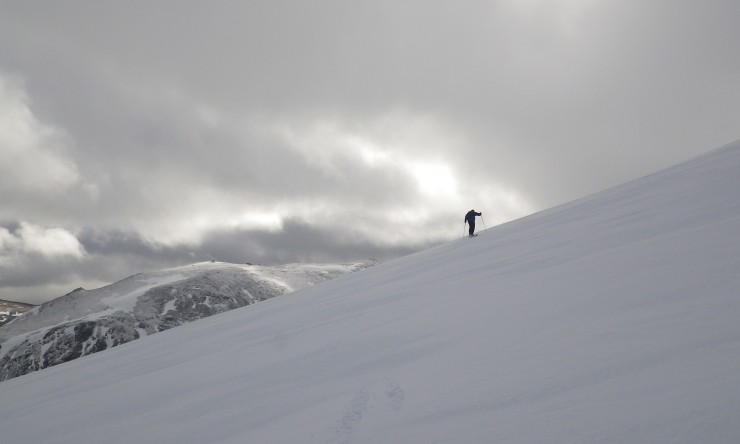 Clear spells between snow showers, looking onto the SE side of Cairngorm, the snow has become very firm