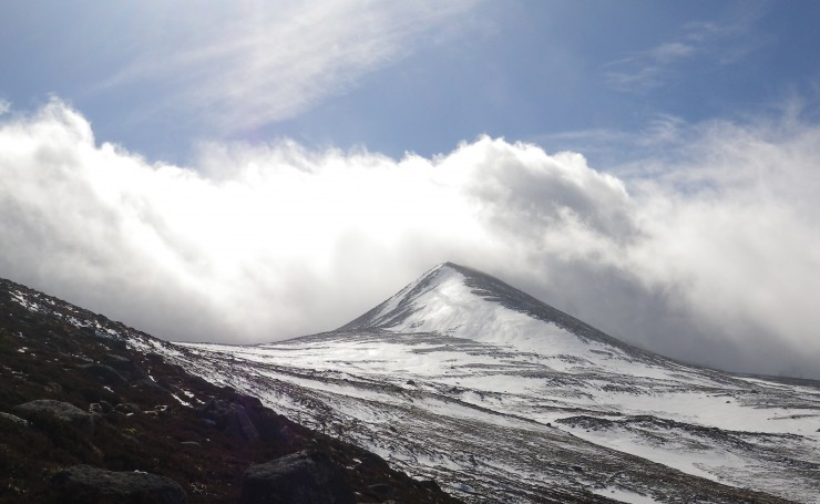 Clouds race over the summits in the gale force winds.