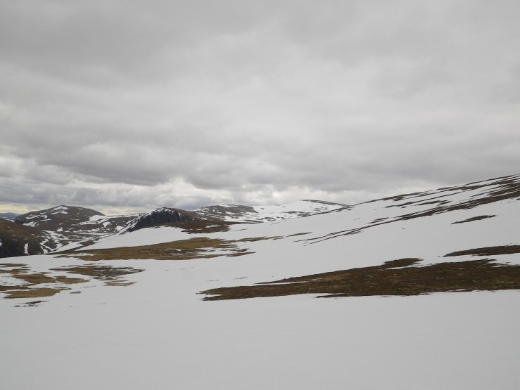 Large snow fields on the plateau.  Ben MacDui in the distance