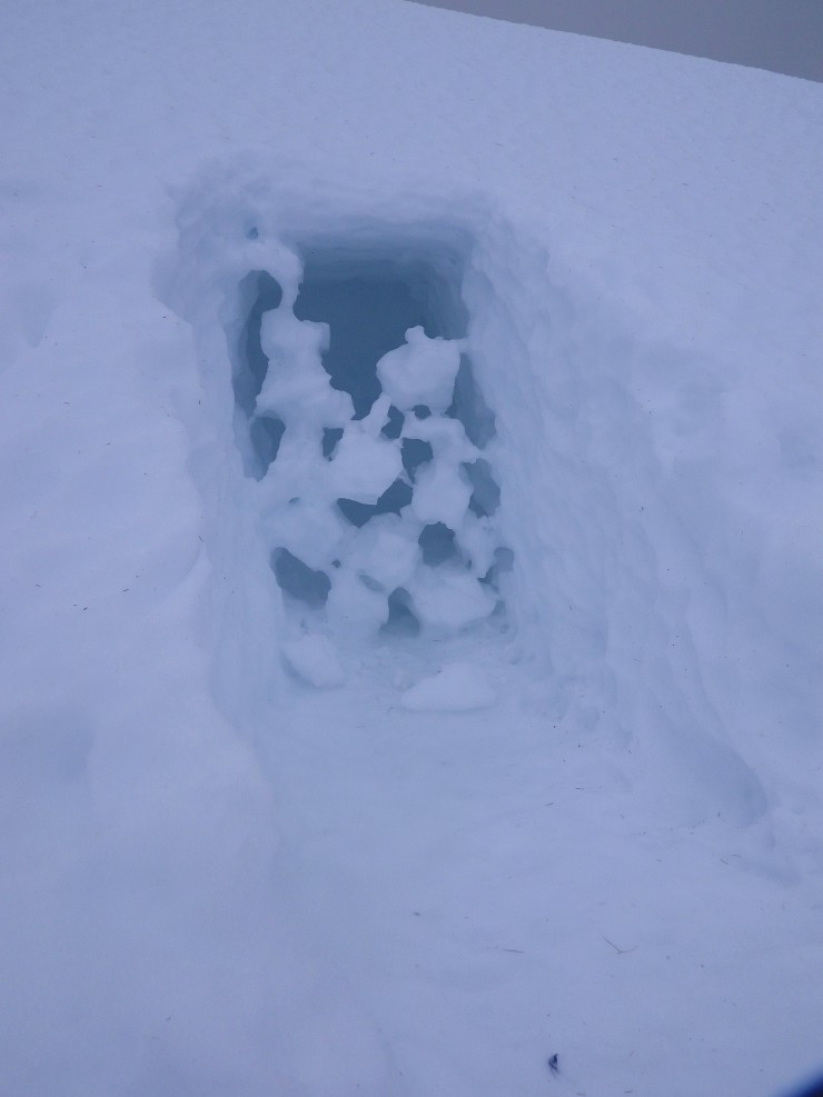 Interesting thaw sculptures over a snow hole entrance