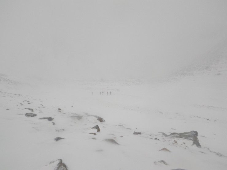 A party crossing Coire an t Sneachda in the gloom