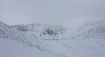 Drifting snow over the tops